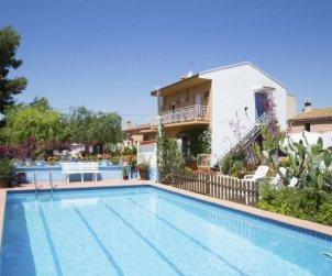 Villa   à Camarles pour 9 personnes avec piscine privée p1